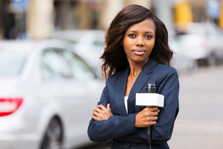 news stand: attractive young african female news reporter