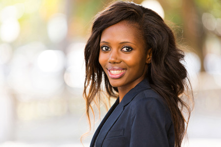 successful business woman: portrait of young african businesswoman standing outdoors Stock Photo