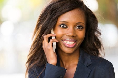 attractive african woman talking on cell phone photo