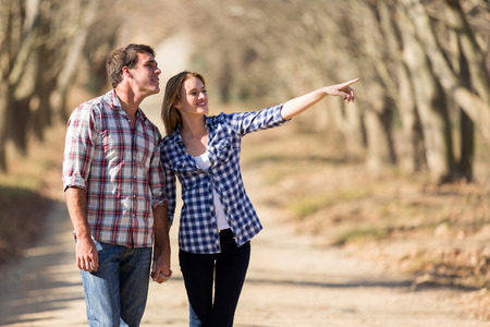 happy couple bird watching outdoors in fall photo