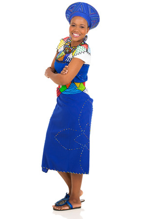 ethnic attire: side view of african woman with arms crossed