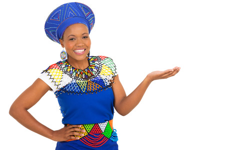 ethnic attire: gorgeous african woman in traditional clothes presenting on white background