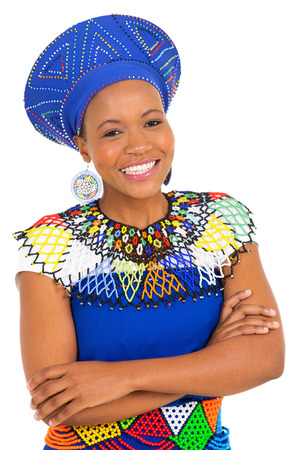ethnic attire: pretty south african woman with arms crossed on white background