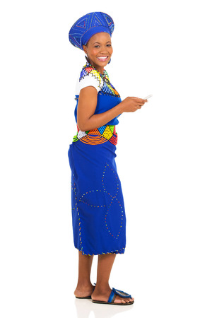 ethnic attire: pretty african zulu woman using smart phone isolated on white