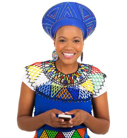zulu: beautiful south african zulu woman using smart phone on white background Stock Photo
