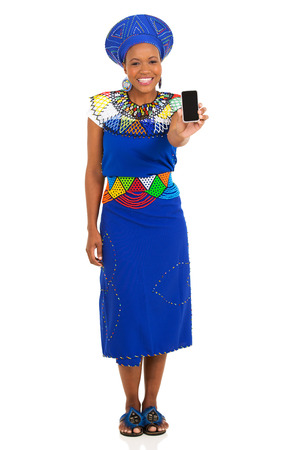 happy african woman: happy young south african woman showing smart phone on white background Stock Photo