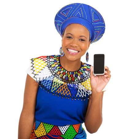 ethnic attire: cheerful african girl in traditional clothes showing smart phone Stock Photo