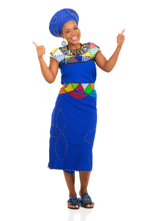 ethnic attire: happy young african zulu woman in traditional clothes giving thumbs up