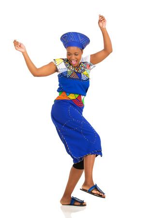 ethnic attire: excited african woman in traditional clothes dancing