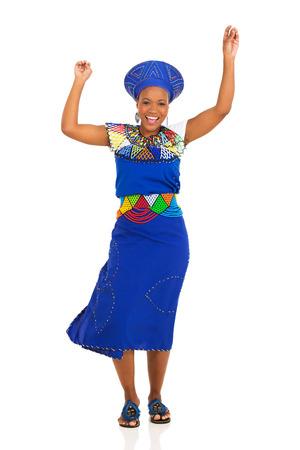 zulu: happy young african zulu woman dancing on white background