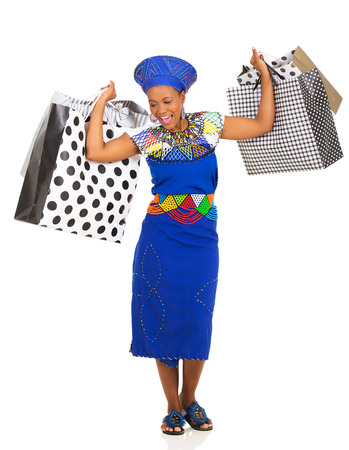 happy african woman: cheerful african zulu woman carrying shopping bags on white background