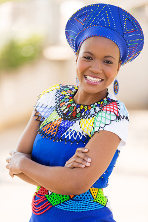 young south african zulu woman in traditional clothes portrait outdoors