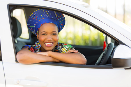 ethnic attire: beautiful african girl inside her new car Stock Photo
