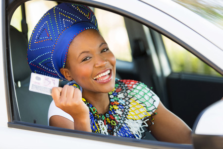 drivers license: happy african woman showing her drivers license she just got