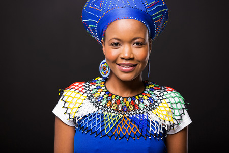zulu: beautiful african woman in traditional clothes portrait on black background Stock Photo