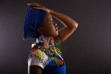 cultural clothing: side view of thoughtful south african woman in traditional clothes Stock Photo