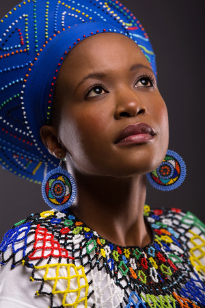 cute african zulu girl in traditional clothes looking up