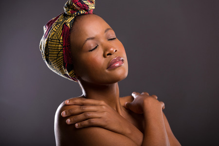 peaceful young african model with eyes closed