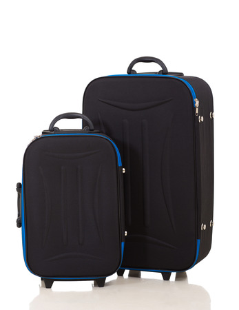 modern large suitcases on white background photo