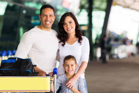 happy travelling family standing at airport photo