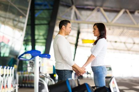 loving couple say good bye at airport photo