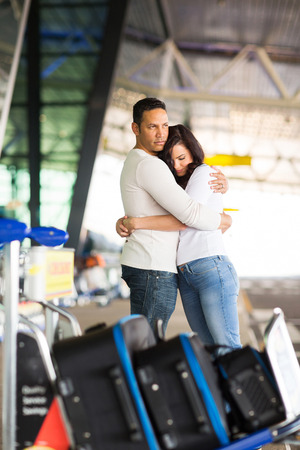 parting: loving married couple parting at airport Stock Photo