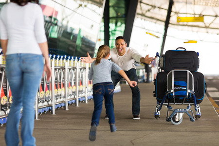 return trip: happy family reunion at airport