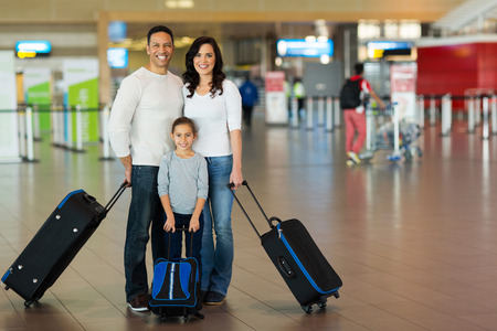 happy family with suitcases at airport Stock Photo