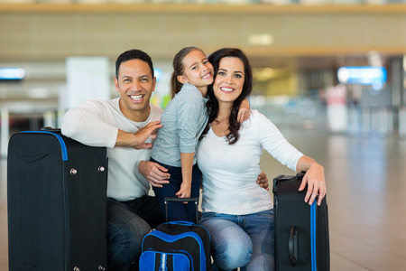 portrait of beautiful family at airport photo