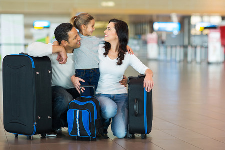 happy family hugging at airport