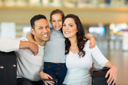 cheerful family portrait at airport  Stock Photo
