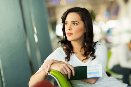 luggage airport: pretty woman waiting for her flight at airport Stock Photo