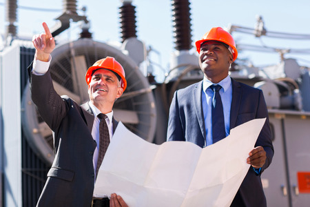 electricity substation: professional managers working in electrical substation