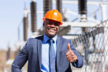 black person: handsome african american electrical manager giving thumb up