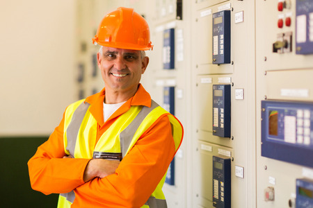 meter box: portrait of senior control room engineer with arms crossed