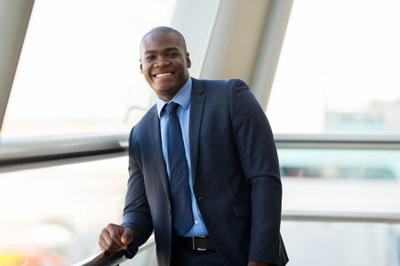 man in suit: handsome african businessman in modern office Stock Photo