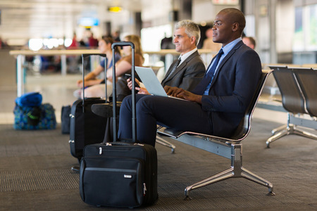 business traveller: business travellers waiting for their flight at airport