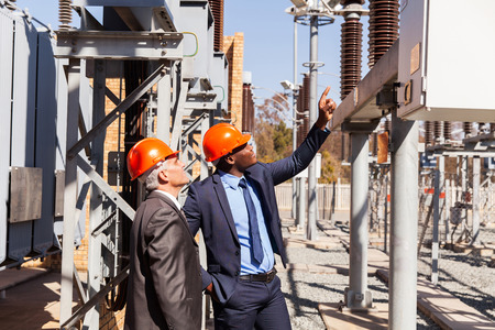outdoor electricity: professional managers inspecting electricity power plant