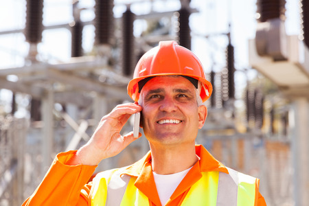 happy senior electrical engineer talking on cell phone  photo