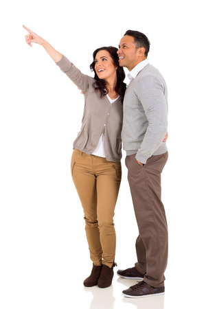 happy married couple pointing on white background photo