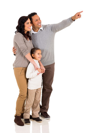 family pointing at empty copy space isolated on white background