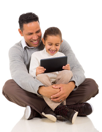 happy father with his little girl using tablet computer on white background photo