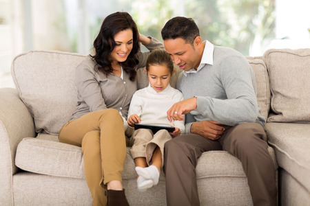beautiful family using tablet computer at home photo