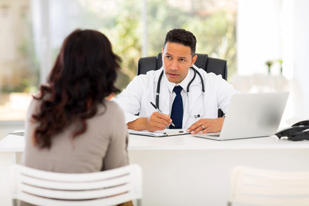 modern doctor: professional medical doctor consulting patient in office