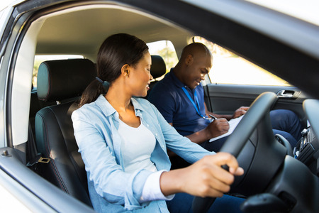 beautiful african girl taking driving lessons photo