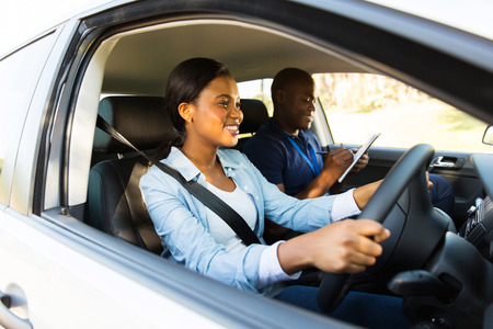 driving: beautiful african woman taking driving test Stock Photo