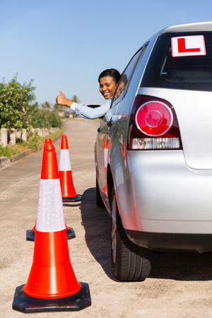 cheerful african student driver giving thumb up photo