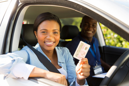 african student driver passes driving test and holding her driver's license Stockfoto