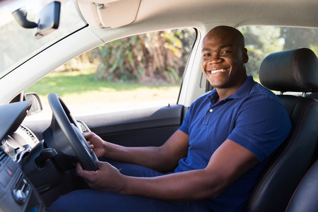 cheerful african man inside his new car Stock Photo