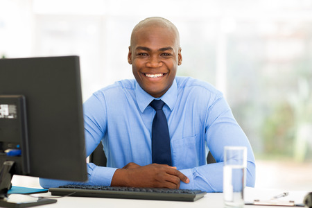 computer desk: portrait of african businessman sitting in office